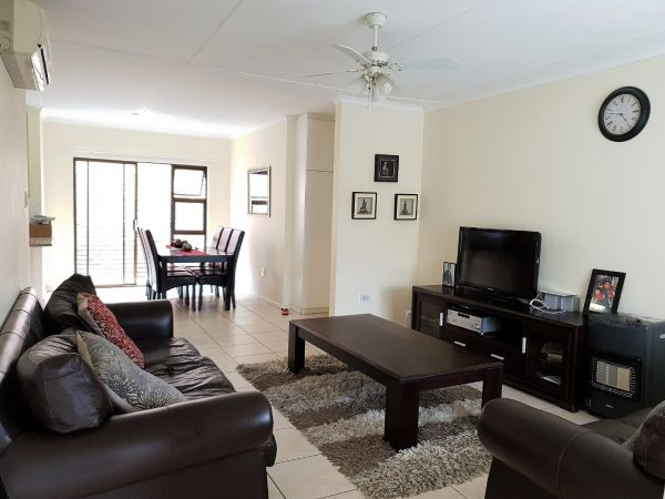 Lovely corner unit townhouse in a POPULAR complex